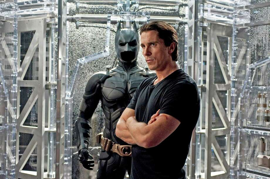 """Christian Bale stars as Bruce Wayne/Batman in Christopher Nolan's acclaimed """"Dark Knight"""" trilogy. The three movies will play back-to-back-to-back on May 11 on the giant IMAX Theater screen of The Maritime Aquarium at Norwalk. Tickets are $50 for all three films. Tickets will not be sold for individual movies. They'll go on sale at 10 a.m. April 18. Get yours at www.maritimeaquarium.org. Photo: Ron Phillips / Warner Bros. Pictures"""