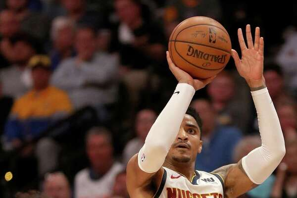 DENVER, COLORADO - APRIL 16: Gary Harris #14 of the Denver Nuggets puts up a shot against Derrick White #4 of San Antonio Spurs in the third quarter during game two of the first round of the NBA Playoffs at the Pepsi Center on April 16, 2019 in Denver, Colorado. NOTE TO USER: User expressly acknowledges and agrees that, by downloading and or using this photograph, User is consenting to the terms and conditions of the Getty Images License Agreement. (Photo by Matthew Stockman/Getty Images)