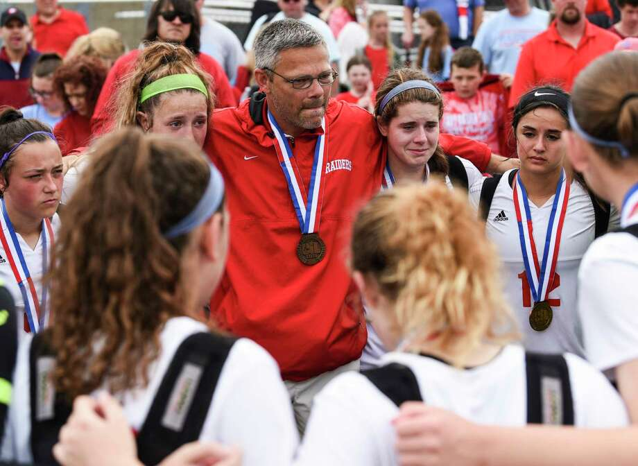 Lumberton's Head Coach Jason Hopson talks to players during the UIL Class 4A girls state semifinal against Stephenville at Birkelbach Field in Georgetown on Wednesday. Lumberton fell 5-1 to the Honeybees. Photo taken on Wednesday, 04/17/19. Ryan Welch/The Enterprise Photo: Ryan Welch, The Enterprise / © 2019 Beaumont Enterprise
