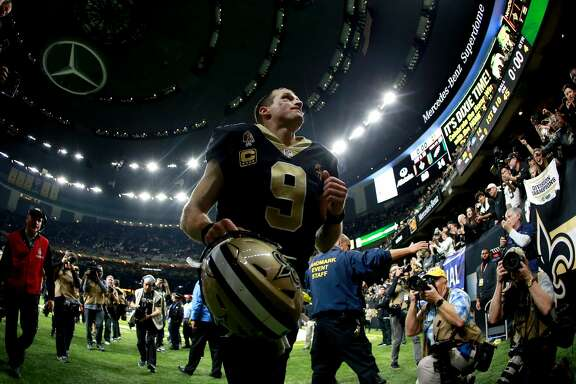 NEW ORLEANS, LOUISIANA - JANUARY 13:  Drew Brees #9 of the New Orleans Saints runs off the field after his teams win over the Philadelphia Eagles in the NFC Divisional Playoff Game at Mercedes Benz Superdome on January 13, 2019 in New Orleans, Louisiana. The Saints defeated the Eagles 20-14. (Photo by Sean Gardner/Getty Images)