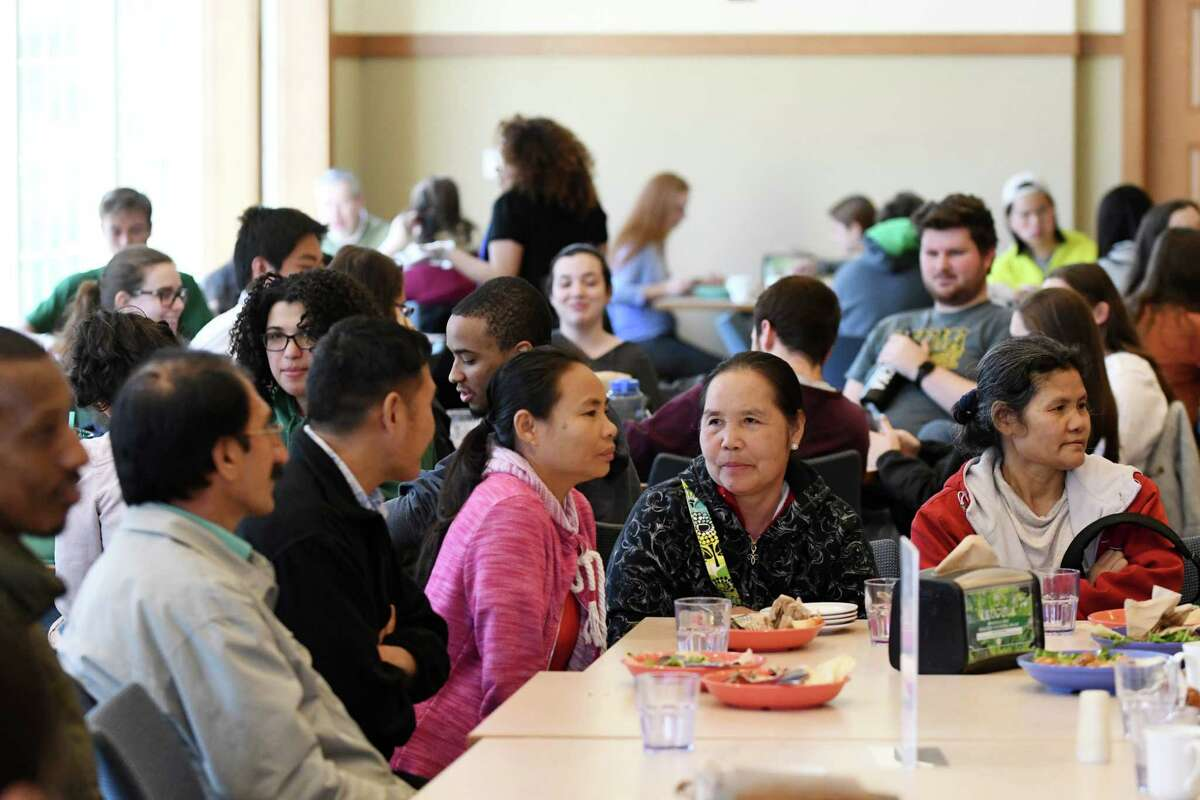 Immigrant guest from several countries gather for lunch at the Community Table during this month's Roots Cafe event in Massry Dining Hall at Siena College on Wednesday, April 17, 2019, in Loudonville, N.Y. Through Refugee and Immigrant Support Services of Emmaus (RISSE), Siena College welcomes several guests from RISSE each month for lunch. They sit with students and staff, to enjoy fellowship and the opportunity to practice their English language skills. The food served generally reflects that of a country that is experiencing conflict, to help raise awareness among students. (Will Waldron/Times Union)