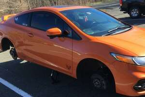 A Honda Civic Si was stripped of its tires and rims while parked in the I-84 Exit 1 commuter lot in Danbury.