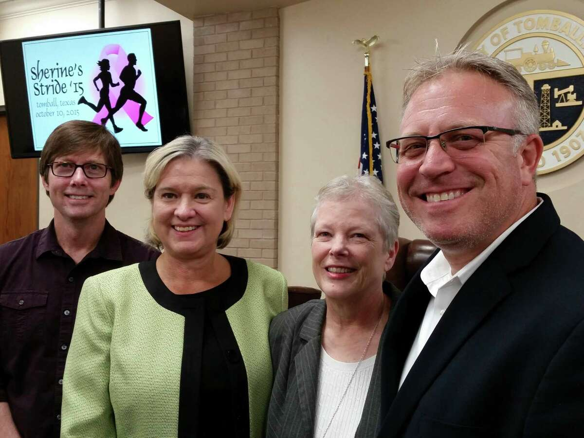 TOMAGWA executive director Judy Deyo, center right, receives a check for $7,588 from Tomball Mayor Gretchen Fagan and Assistant City Manager Rob Hauck during a recent meeting of the Tomball City Council. Also shown is TOMAGWA team member Rick Brown.