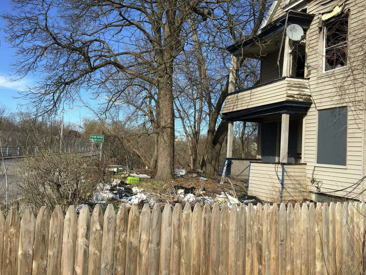 This city-owned property at 792 Francis Avenue is strewn with trash on Wednesday, April 17, 2019, in Schenectady, N.Y. Neighbors are upset with the ill-kept eyesore. The city owns the property after taking it in a tax foreclosure in 2017. (Paul Nelson/Times Union)