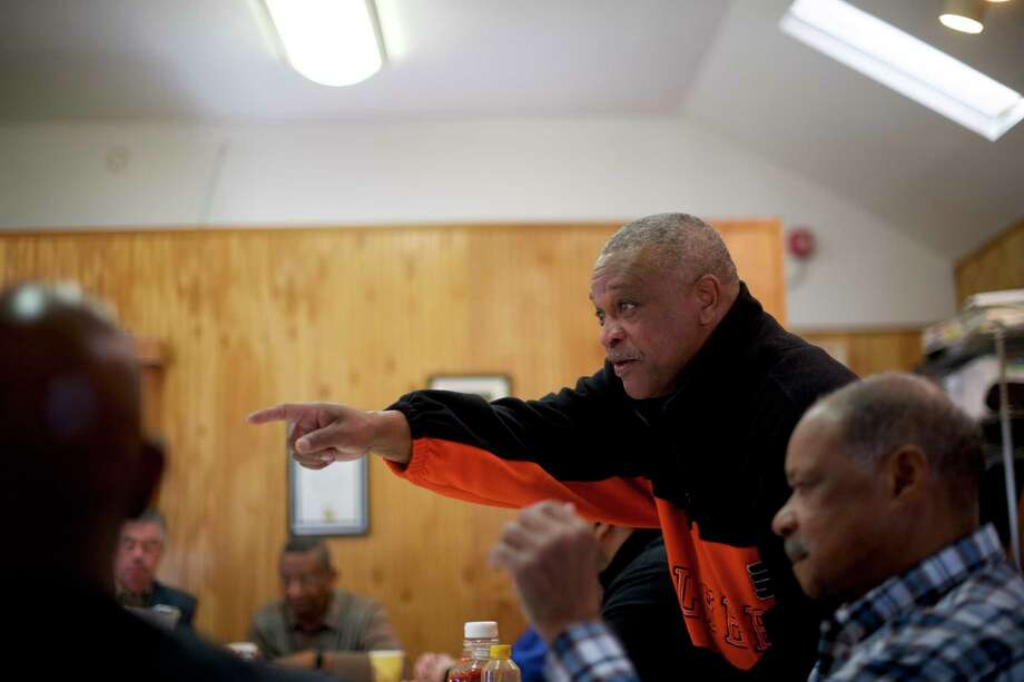 Charles Johnson, the grandfather of wrestler Andrew Johnson, a high school sophomore whose dreadlocks were sheared off before a wrestling match late last year, attends a men's group at the First Baptist Church in Richland, N.J. in mid-March. Photo: Photo For The Washington Post By Mark Makela / Mark Makela