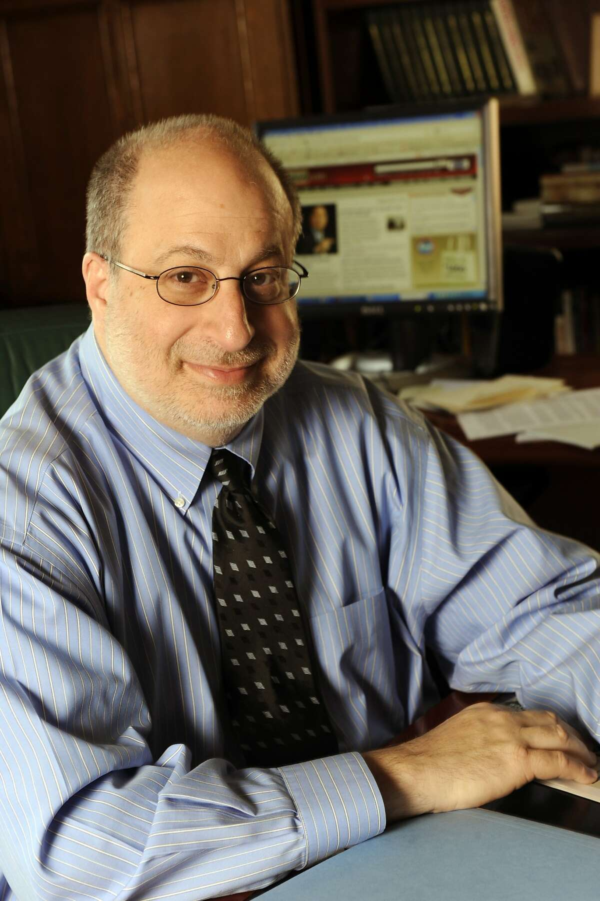 Detroit News Editor and Publisher Jonathan Wolman is seen in his office on April 27, 2009. Wolman, who previously worked as a reporter, Washington bureau chief and executive editor at The Associated Press, died Monday, April 15, 2019. He was 68. (Donna Terek/Detroit News via AP)