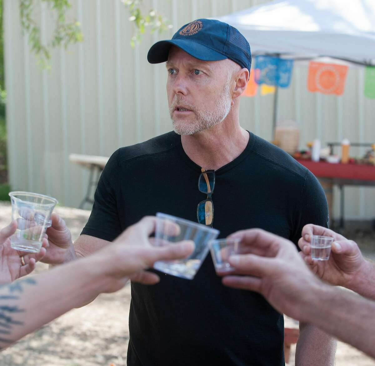 Lance Winters, head distiller for St. George Spirits, toasts with friends while tasting mezcal at an agave event in Woodland. The Mezcalifornia group gathered at an agave farm in Woodland for an event to post the agave - the first step in the production of mezcal - on Sunday, April 14, 2019. Mezcalifornia hopes to be California's first agave distillate.
