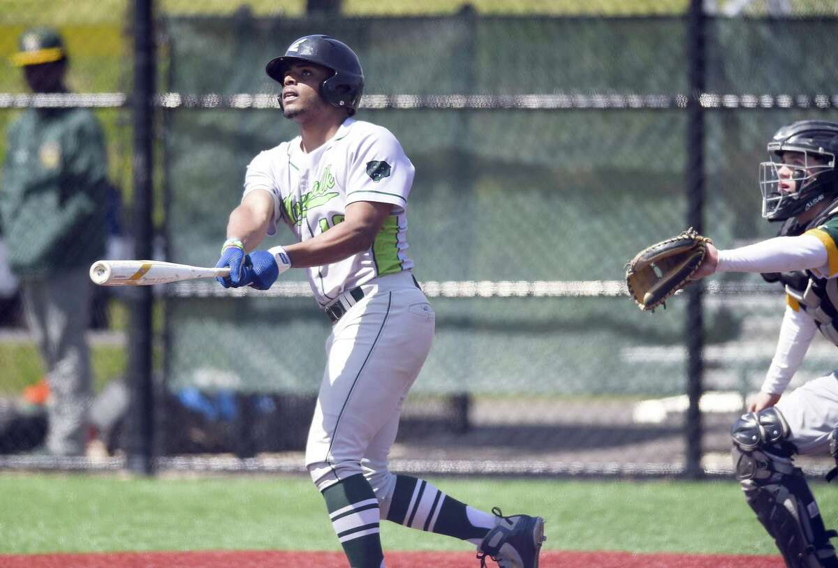 Norwalk's Gavin Kee follows his two-run homer in the fifth inning of a FCIAC baseball game against Trinity Catholic at the Callahan Complex on Wednesday, April 17, 2019 in Norwalk, Connecticut. Norwalk defeated Trinity 13-3 (5).
