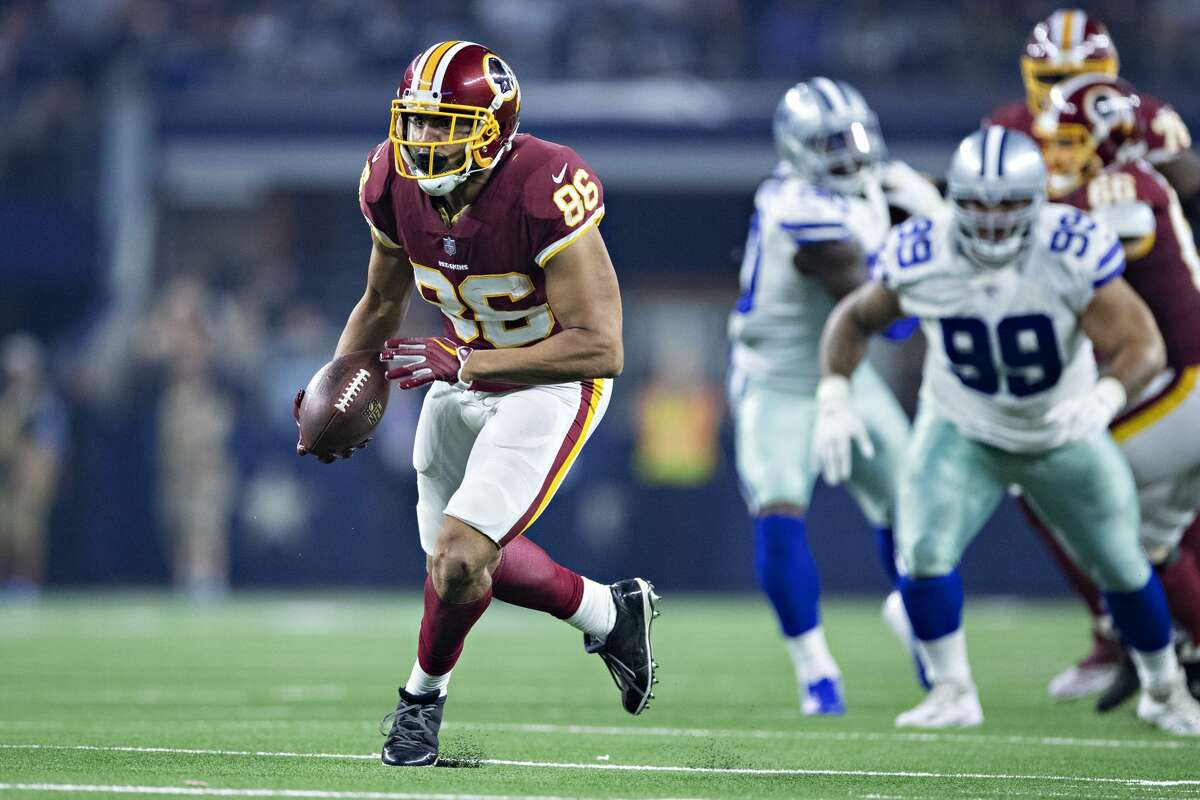 Jordan Reed of the Washington Redskins runs the ball during a game against the Dallas Cowboys at AT&T Stadium on November 22, 2018 in Arlington, Texas. The Cowboys defeated the Redskins 31-23.