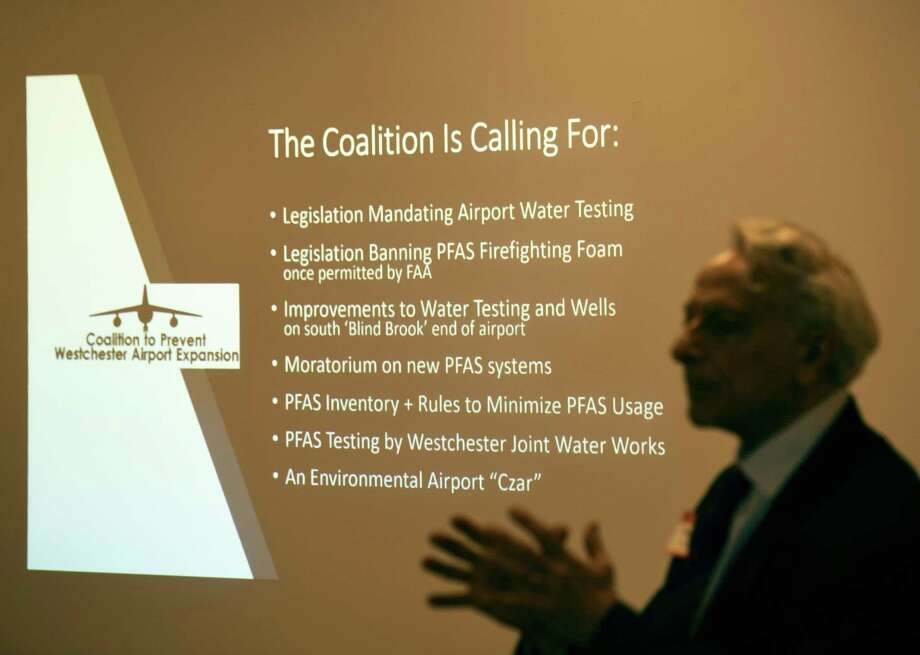 Geoge Klein speaks on behalf of the Coalition to Prevent Westchester Airport Expansion about an emerging threat of water contamination at the Westchester County Airport during a presentation at the BelleFair Community Room in Rye Brook, N.Y. Wednesday, April 17, 2019. A class of contaminants known as PFAS pose a risk to pollute the Kensico Reservoir, which provides drinking water for a large portion of Westchester and New York City residents. Photo: Tyler Sizemore / Hearst Connecticut Media / Greenwich Time