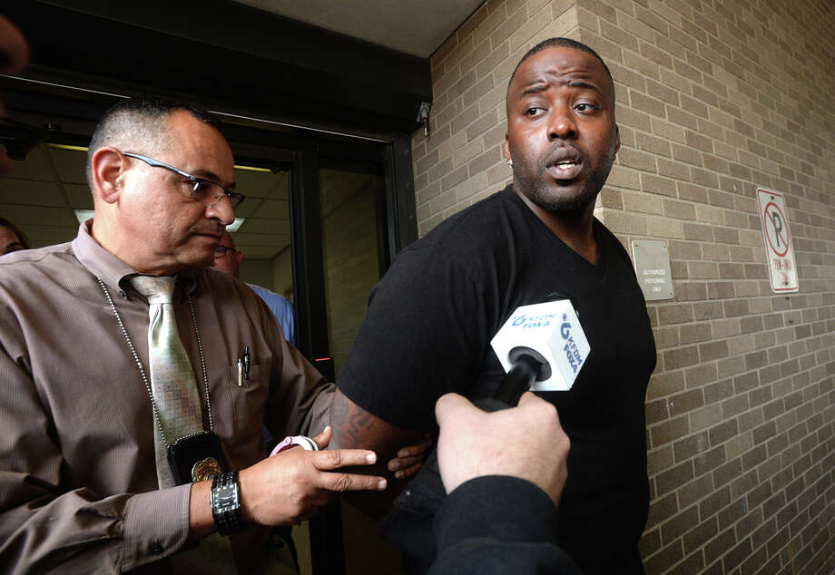 "Bernard Bell is led away from the Beaumont Police Department after being arrested Wednesday on a federal charge of possession of a firearm. Sunday's possession charge was elevated to a federal level after further investigation into Bell's history became known to investigators, Lt. Curtis Breaux said. ""If anyone warrants federal charges, it's him,"" he added. Bell, who had bonded out of jail following Sunday's arrest was taken into custody today without incident. Lt. Breaux says preliminary tests indicate the gun, which they have now identified as a 45-caliber handgun, was likely the one used in the shooting death of Anthony Wilson last Thursday. The weapon had been reported stolen two weeks prior to the incident, and was taken from a car burglary in the same neighborhood of Wilson's shooting. Photo taken Wednesday, April 17, 2019 Kim Brent/The Enterprise Photo: Kim Brent/The Enterprise"