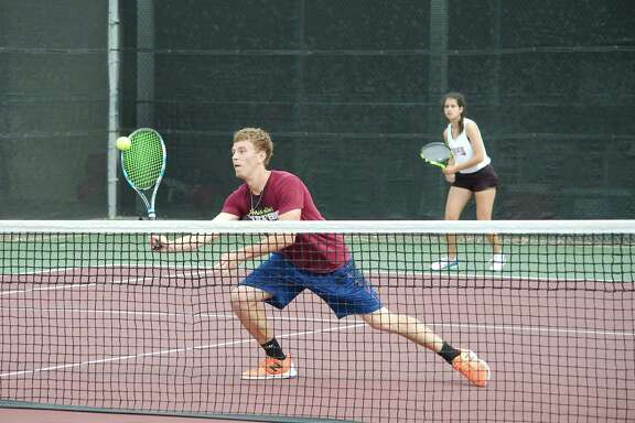 Clear Creek's Griffin Baillargeon and Alejandra Lopez compete in the mixed doubles bracket Wednesday at the Region III-6A tournament at Deer Park High School.