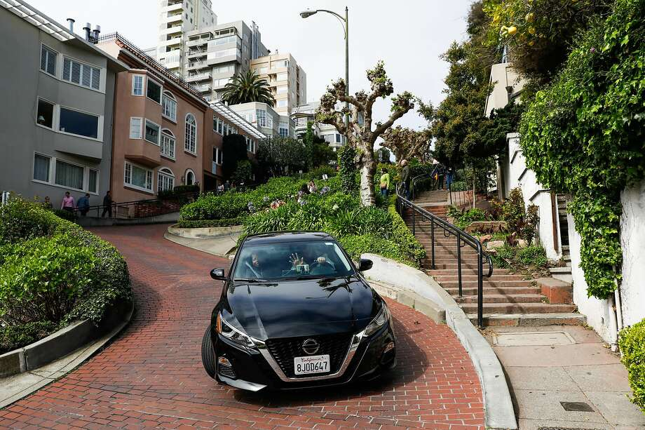 A car goes down Lombard Street in San Francisco, California, on Sunday, April 14, 2019. Photo: Gabrielle Lurie, The Chronicle