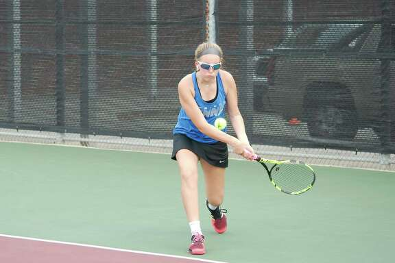 Clear Springs' Allison Schwartz prepares to hit a backhand in the Region III-6A tennis tournament Wednesday at Deer Park High School.