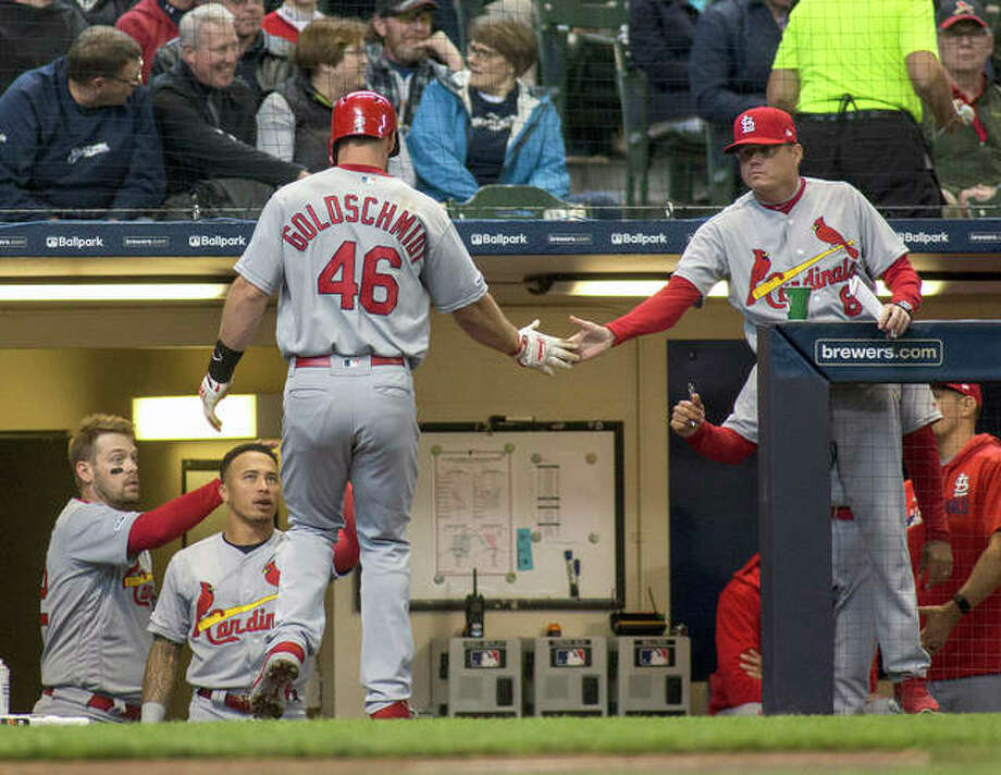 The Cardinals' Paul Goldschmidt is congratulated by manager Mike Schildt scoring off a RBI single by Paul DeJong in Wednesday's win in Milwaukee. Photo: AP Photo