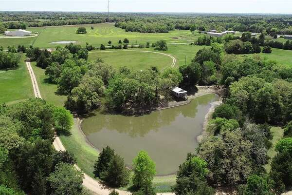 Located at 10000 FM 389 in Brenham, this 78-acre mega-ranch features a three bedroom, three bathroom Tuscany-style house complete with its own infinity pool and campsite.Located next to a one-and-a-half acre stocked pond, the camp features one main building with a kitchen and dining space, multiple cabins, gazebo, fire pit area and sundecks. Multiple trails to spring-fed streams and waterfalls are also found throughout the property.