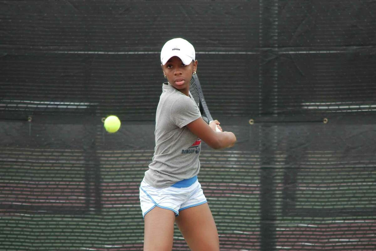 Dawson's Trinity Hatchett concentrates on a backhand during the Region III-6A tennis tournament Wednesday at Deer Park High School.