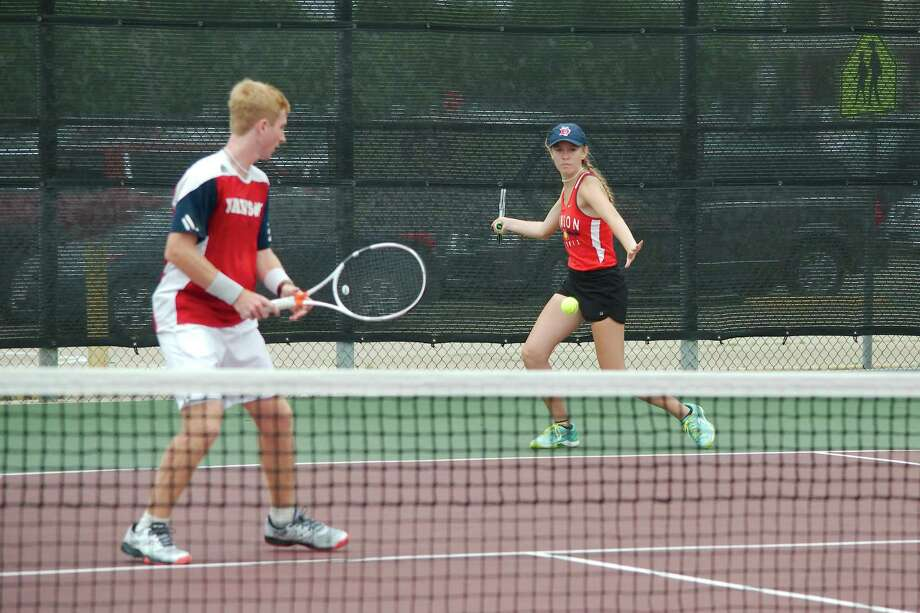 Dawson's Danielle Rhodes attempts to hit a forehand in the open court while teammate Ethan Martin observes in the mixed doubles bracket of the Region III-6A tennis tournament at Deer Park High School. Photo: Kirk Sides / Staff Photographer / © 2019 Kirk Sides / Houston Chronicle
