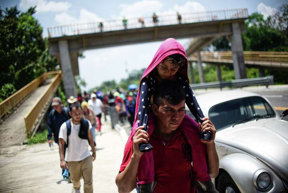 Central American migrants heading in caravan to the US rest beside the road between Metapa and Tapachula in Mexico on April 12. They do not, as the president essentially charges, pose an existential threat. Photo: PEP COMPANYS /AFP /Getty Images / AFP or licensors