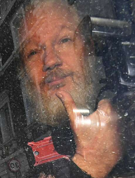 Julian Assange gestures as he arrives at Westminster Magistrates' Court in London, after the WikiLeaks founder was arrested by officers from the Metropolitan Police and taken into custody April 11. Assange is not a journalist.