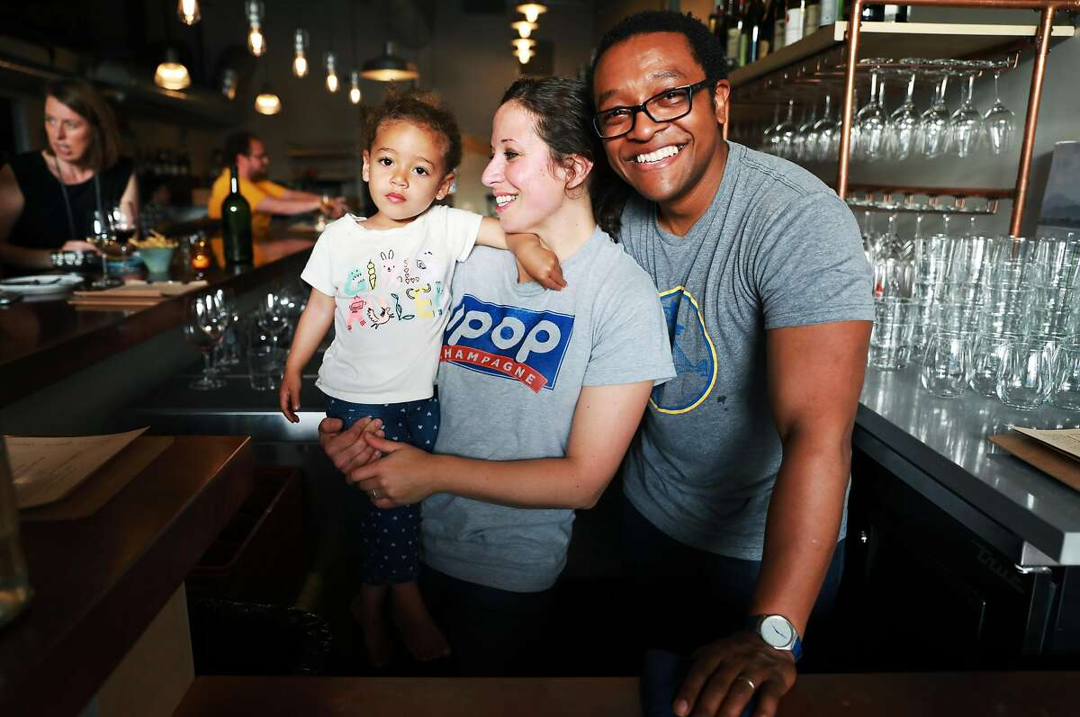 Edith, 2, poses for a photo with her parents Rebecca Fineman and Chris Gaither at Ungrafted, a wine bar located at 2419 3rd St., in San Francisco, Calif., on Wednesday, April 10, 2019.