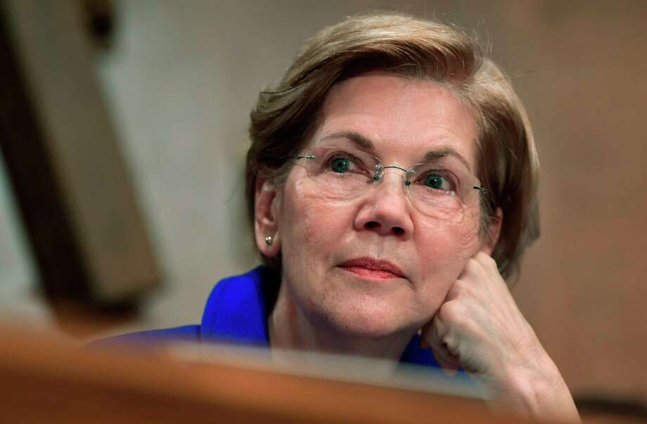 FILE - In this Dec. 5, 2017, file photo, Sen. Elizabeth Warren, D-Mass., waits to speak during a meeting of the Senate Banking Committee on Capitol Hill in Washington. (AP Photo/Susan Walsh, File) Photo: Susan Walsh / Copyright 2017 The Associated Press. All rights reserved.