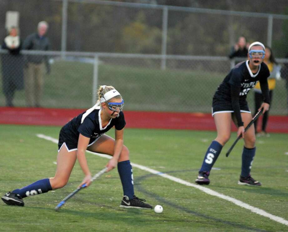 Staples' Elle Fair plays the ball into the circle during a Class L semifinal against Enfield in November 2016. Photo: Ryan Lacey / Hearst Connecticut Media