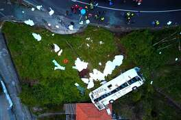 A video grab obtained from drone footage shows the wreckage of a tourist bus that crashed on April 17, 2019 in Canico, on the Portuguese island of Madeira. - At least 28 people were killed when a tourist bus crashed on the Portuguese island of Madeira, the local mayor told local media. The regional protection service did not confirm the toll when questioned by AFP. (Photo by STRINGER / AFP)STRINGER/AFP/Getty Images