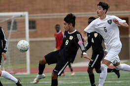 Sharpstown junior Ulises Reyes (8) controls the ball against Kingwood Park junior Robert Henry (6) during the second half of their Region III-5A Boys Soccer finals matchup at Turner Stadium in Humble on Saturday, April 13, 2019.