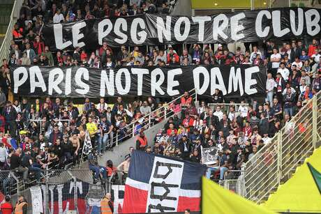 Paris Saint-Germain's supporters pay homage to Notre-Dame cathedral two days after a fire ripped through its roof, during the French L1 football match between Nantes (FC Nantes) and Paris Saint-Germain (PSG) at the La Beaujoire stadium in Nantes, western France, on April 17, 2019.