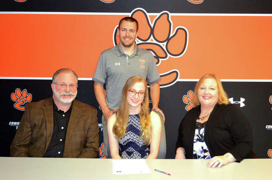 Edwardsville senior Morgan Rockwell, seated middle, signed to compete in women's swimming and the triathlon at Millikin University in Decatur. She is joined by her parents and EHS coach Christian Rhoten. Photo: Scott Marion/The Intelligencer