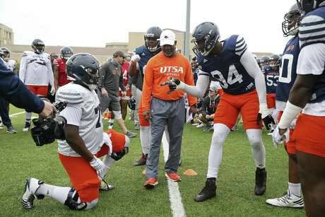 Defensive end Salomon Wise, (94), right, taunts center Bosah Osakwe, (75), before a bird cage match during the University of Texas at San Antonio football team spring practice at the main campus, Monday, March 25, 2019.