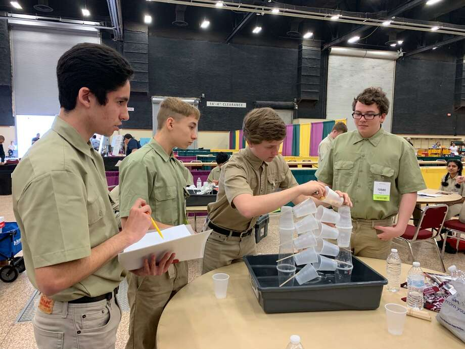 Four students from Conroe High School secured first place as a first-time team during the applied engineering contest at the SkillsUSA state competition in Corpus Christi earlier this month. They were tasked with building an irrigation system using plastic cups, Popsicle sticks and aluminum foil. Photo: Submitted Photo / Submitted Photo