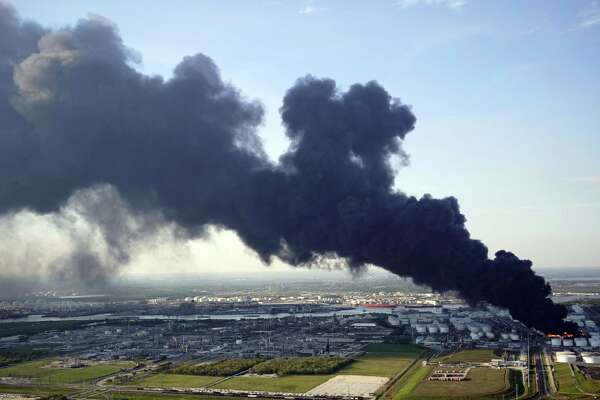 FILE - In this March 18, 2019 file photo, a plume of smoke rises from a petrochemical fire at the Intercontinental Terminals Company in Deer Park, Texas. Organizers say an annual event marking the Battle of San Jacinto and re-enactment of the fight for Texas independence has been canceled amid continuing cleanup from the Houston-area chemical plant fire. The Texas Parks & Wildlife Department says the San Jacinto Battleground State Historic Site in La Porte remains closed and the April 21 ceremony is canceled. The Battleship Texas site also remains closed. The April 21, 1836, Battle of San Jacinto was a major victory for Texas seeking its independence from Mexico. (AP Photo/David J. Phillip)