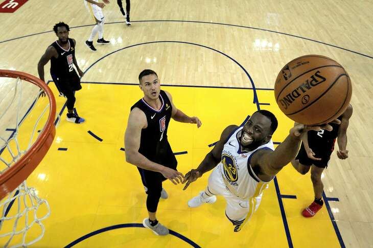 Draymond Green (23) goes in for a layup as the Golden State Warriors played the Los Angeles Clippers in Game 1 of the First Round of the NBA Playoffs at Oracle Arena in Oakland, Calif., on Saturday, April 13, 2019.