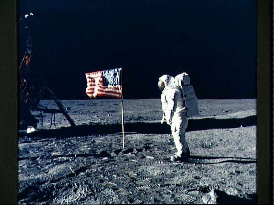 Astronaut Edwin E. Aldrin Jr., lunar module pilot, poses for a photograph beside the deployed United States flag during Apollo 11's extravehicular activity on the lunar surface. This picture was taken by mission commander Neil A. Armstrong. Photo: NEIL A. ARMSTRONG, MBR / TNS / NASA