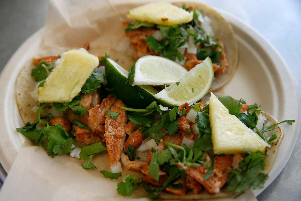 Tacos al pastor are served at the Al Pastor Papi food truck on Fourth Street in Mission Bay in San Francisco, Calif. on Saturday, April 6, 2019.
