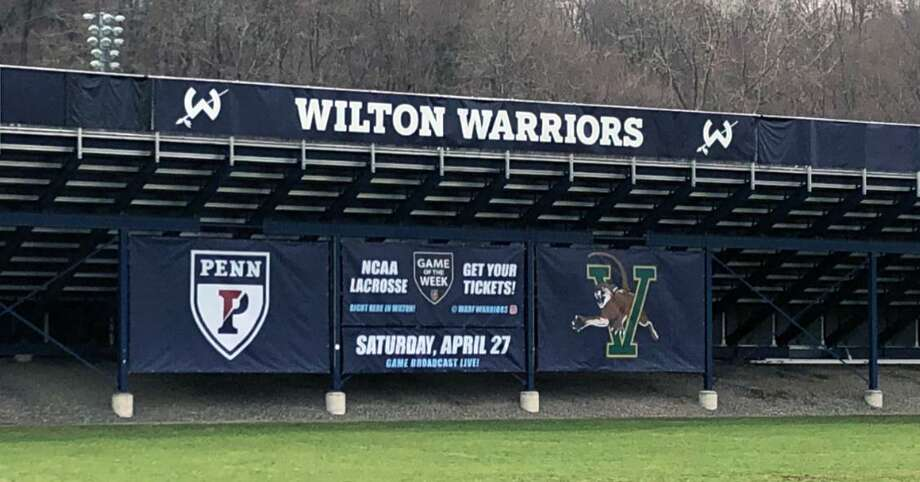 A sign promoting an NCAA men's lacrosse game between Penn and Vermont at Wilton High School's Fujitani Field. Photo: Contributed Photo / Stamford Advocate Contributed