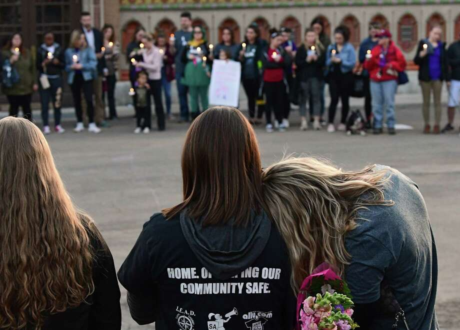 People affected by sexual violence gather at Washington Park Lake House for a Take Back the Night vigil after marching on Wednesday, April 17, 2019 in Albany, N.Y. (Lori Van Buren/Times Union) Photo: Lori Van Buren, Albany Times Union / 20046705A