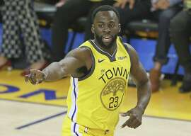 Golden State Warriors Draymond Green points in the first quarter during game 2 of the Western Conference Playoffs between the Golden State Warriors and the Los Angeles Clippers at Oracle Arena on Monday, April 15, 2019 in Oakland, Calif.
