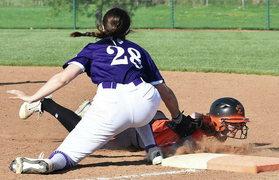 Edwardsville's Mackenzie Owens slides safely back into first base on a pick-off attempt during Wednesday's game against Collinsville. Edwardsville softball in action against Collinsville. Photo: Matt Kamp/The Intelligencer