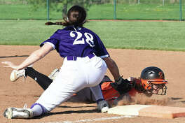 Edwardsville's Mackenzie Owens slides safely back into first base on a pick-off attempt during Wednesday's game against Collinsville. Edwardsville softball in action against Collinsville.