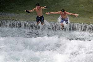 Swimmers jumped into white water as tubers enjoyed the Comal River in New Braunfels last year. Comal County continues showing significant population growth, ranking second nationally among U.S. counties recording the largest percentage gains in new residents in a single year, census numbers show.