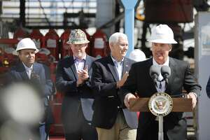 Vice President Mike Pence looks on as Diamondback Energy CEO Travis Stice speaks at an active oil and gas operation April 17, 2019, in Midland County. Pence toured a Latshaw Drilling Rig and made statements about United States trade negotiations.  James Durbin / Reporter-Telegram