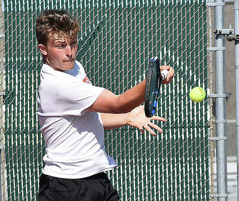 Edwardsville's Nick Hobin hits a forehand shot during singles action against Alton Marquette. Photo: Matt Kamp/The Intelligencer