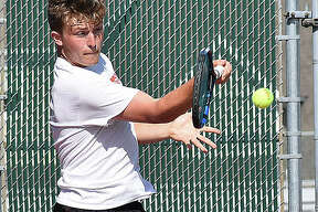 Edwardsville's Nick Hobin hits a forehand shot during singles action against Alton Marquette.