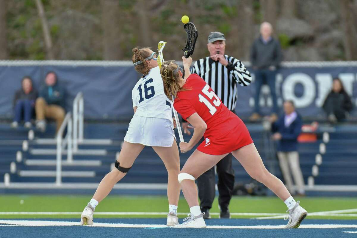 Meghan Lane (16) of the Wilton Warriors and Leah Caputo (15) of the Greenwich Cardinals draw for possession during a game on Wednesday April 17, 2019 at Wilton High School, in Wilton, Connecticut.