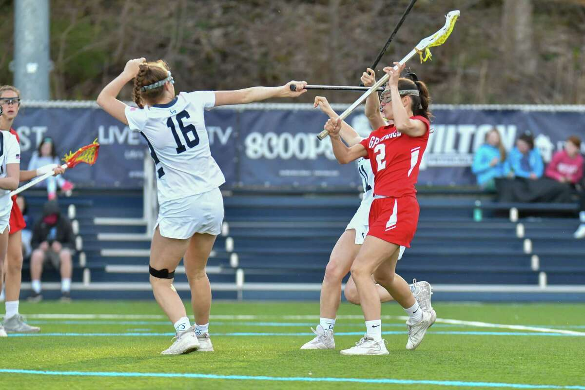 Paige Finneran (2) of the Greenwich Cardinals shoots and scores during a game against the Wilton Warriors on Wednesday April 17, 2019 at Wilton High School, in Wilton, Connecticut.