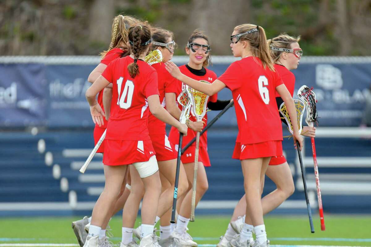 The Greenwich Cardinals celebrate a first half goal during a game against the Wilton Warriors on Wednesday April 17, 2019 at Wilton High School, in Wilton, Connecticut.