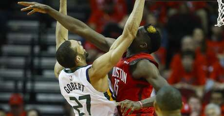 Houston Rockets center Clint Capela (15) tries to block a shot by Utah Jazz center Rudy Gobert (27) during the second half of the first round of the NBA playoffs at Toyota Center, Sunday, April 14, 2019, in Houston.